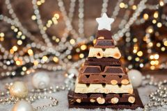 Chocolate Christmas tree in front of booked lights. Selective focus royalty free stock photography