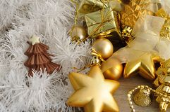 A chocolate christmas tree shape displayed with tinsel and golden Christmas decorations Stock Image
