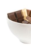 Chocolate chunks. Variety of chocolate chunks in the white bowl stock images