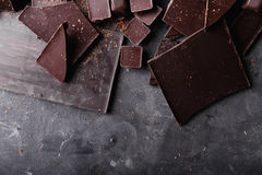 Chocolate chunks. Chocolate bar pieces.  A large bar of chocolate on gray abstract background. Chocolate candies. Royalty Free Stock Image