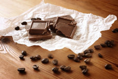 Chocolate, cinamon and coffee beans on wooden table. selective focus. natural light. Stock Images