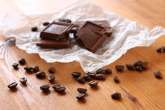 Chocolate, cinamon and coffee beans on wooden table. selective focus. natural light. Stock Photos