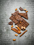Chocolate with cinnamon and almonds. Royalty Free Stock Image