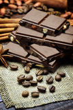 Chocolate, cinnamon, anise, coffee beans.Spices and chocolate on Royalty Free Stock Image