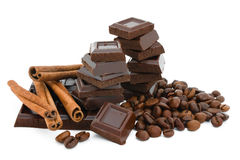Chocolate,cinnamon and coffee beans. Royalty Free Stock Photos