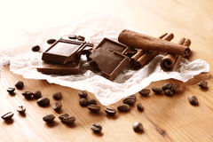 Chocolate, cinnamon and coffee beans on wooden table. selective focus. natural light. Stock Images