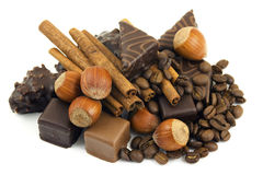 Chocolate, cinnamon, nuts, coffee beans Stock Image