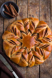 Chocolate and cinnamon star braided bread stock image