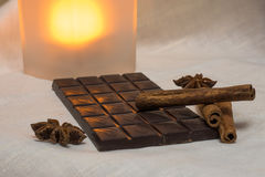 Chocolate, cinnamon sticks and star anise. Tender milk chocolate and cinnamon with anise on a wooden background Royalty Free Stock Image