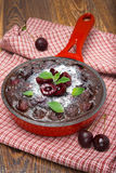 Chocolate clafoutis with cherries in a frying pan Stock Photos