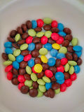Chocolate. Close up of multicoloured chocolate buttons Stock Photos