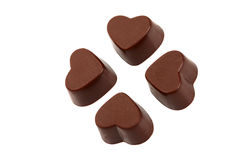 Chocolate Clubs. Chocolates in heart-shaped, arranged in the form of clubs Stock Images