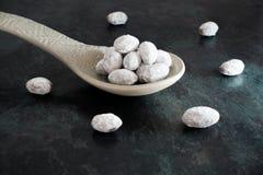 Chocolate coated Almonds on big Spoon Stock Photography