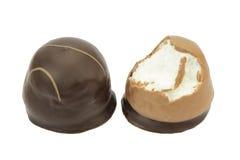 Chocolate coated cream puffs. Danish cuisine. Royalty Free Stock Image