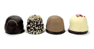 Chocolate coated cream puffs. Danish cuisine. Royalty Free Stock Photography