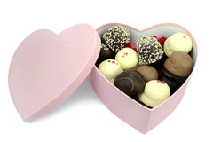 Chocolate coated cream puffs in a heart shape box. Royalty Free Stock Photography