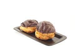 Chocolate coated fresh cream puffs Stock Photography