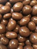 Chocolate coated nuts. Stacked chocolate coated nuts. Depth giving image. The image related food, health, diet, obesity ,desert etc. ıt can use design of royalty free stock photos