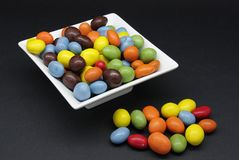 Chocolate coated peanuts Stock Images