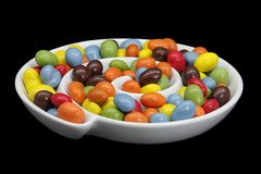 Chocolate coated peanuts Stock Photos