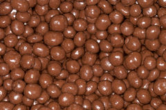 Chocolate coated raisins Stock Photos