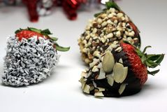 Chocolate coated strawberry with almonds and coconuts Royalty Free Stock Images
