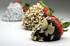 Chocolate coated strawberry with almonds Stock Image