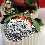 Chocolate coated strawberry with coconut Stock Photo