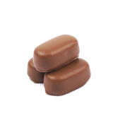 Chocolate coated toffee candy isolated Stock Image