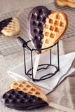 Chocolate coated waffle heart popsicles Stock Images