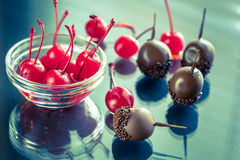 Chocolate and cocktail cherries on the glass Royalty Free Stock Photo