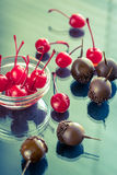 Chocolate and cocktail cherries on the glass Stock Photo