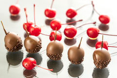 Chocolate and cocktail cherries on the glass Stock Photography