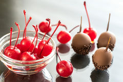 Chocolate and cocktail cherries on the glass Stock Image