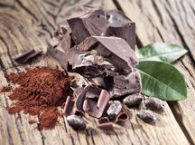 Chocolate and cocoa bean over wooden. Stock Image