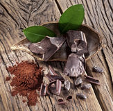 Chocolate and cocoa bean over wooden table. Stock Image