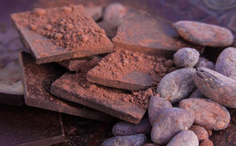 Chocolate, cocoa beans and ground cocoa. Chocolate chunks, cocoa beans and ground cocoa closeup Stock Photos