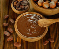 Chocolate, cocoa beans and hazelnuts Royalty Free Stock Photo
