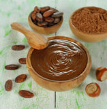 Chocolate, cocoa beans and hazelnuts Royalty Free Stock Images