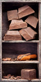 Chocolate and cocoa beans in a vintage box. collage Stock Photos