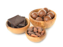 Chocolate and cocoa beans in a wooden bowl Royalty Free Stock Image