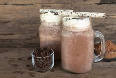 Chocolate and cocoa mixed with milk smoothies on wooden floor. stock photos