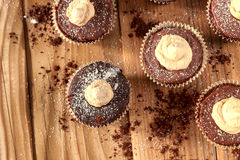 Chocolate cocoa muffins with meringue on the top Royalty Free Stock Photos