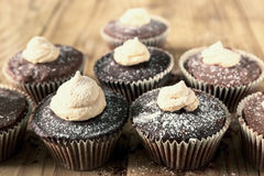 Chocolate cocoa muffins with meringue on the top Royalty Free Stock Photography