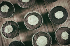 Chocolate cocoa muffins with meringue on the top Stock Photos