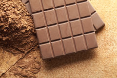 Chocolate and cocoa on paper sheet. Chocolate and cocoa on handmade paper sheet Royalty Free Stock Photo