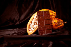 Chocolate With Cocoa Pods On Black Royalty Free Stock Photography