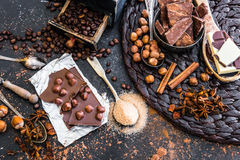 Chocolate, cocoa and various spices on table Royalty Free Stock Photos