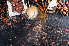 Chocolate, cocoa and various spices on table Royalty Free Stock Photo