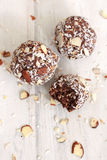 Chocolate Coconut balls. Chocolate coconut almond balls partially eaten Stock Images